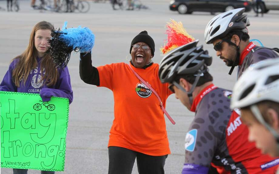 Sandra Mason cheers on the riders at the 29th Annual BP MS 150 trek from Houston to Austin, Saturday, April 20, 2013 at Rhodes Stadium in Katy, Texas. Approximately 12,000 cyclists will embark on the two-day, 180-mile journey to drive awareness for a cure for multiple sclerosis. (AP Photo/The Courier, Alan Warren)