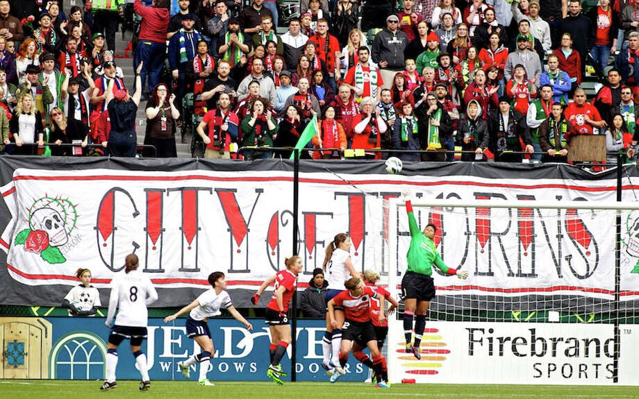 Portland Thorns goalkeeper Karina LeBlanc (1) makes a save against the Seattle Reign at JELD-WEN Field on April 21, 2013. Photo: Craig Mitchelldyer, Portland Thorns FC / Portland Thorns FC
