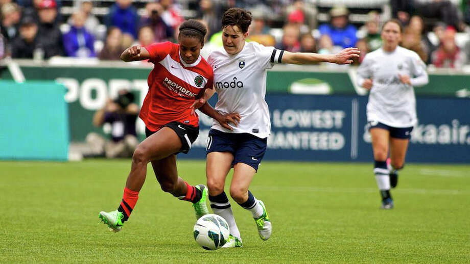 Portland Thorns forward Nikki Washington (21) fights for possession against Seattle Reign player Keelin Winters (11) at JELD-WEN Field on April 21, 2013. Photo: Craig Mitchelldyer, Portland Thorns FC / Portland Thorns FC