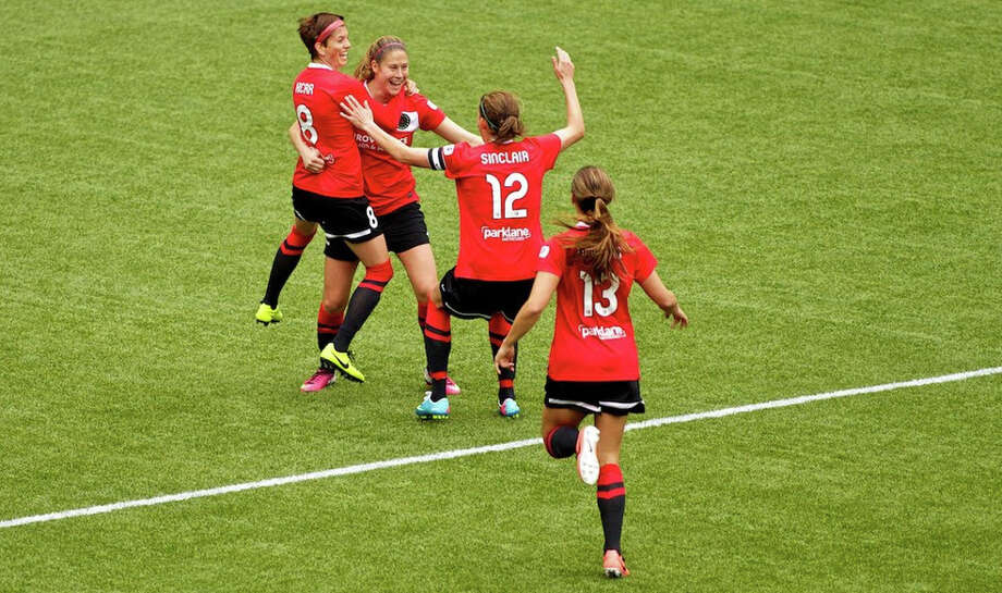 The Thorns celebrate the first goal of the match at JELD-WEN Field on April 21, 2013. Photo: Craig Mitchelldyer, Portland Thorns FC / Portland Thorns FC