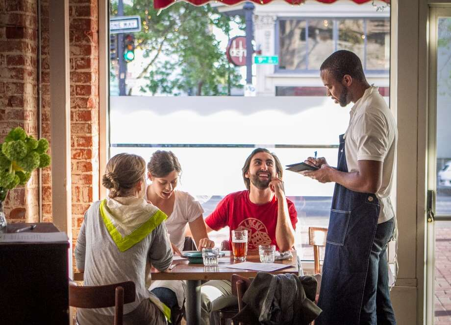 A server takes an order at Miss Ollie\'s.