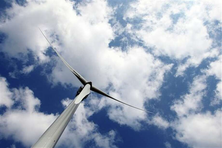 Buy a wind turbine if you're in a rural area. Photo: David Vincent, AP / AP