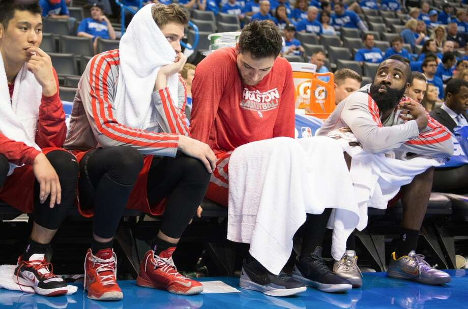 From left, Rockets point guard Jeremy Lin, small forward Chandler Parsons, shooting guard Carlos Delfino and shooting guard James Harden, sit on the bench during the loss to the Thunder in Game 1. Photo: Smiley N. Pool, Houston Chronicle