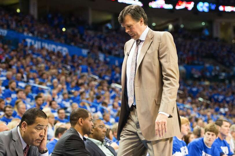 Houston Rockets head coach Kevin McHale and assistant coach Kelvin Sampson, left, react after a Thun