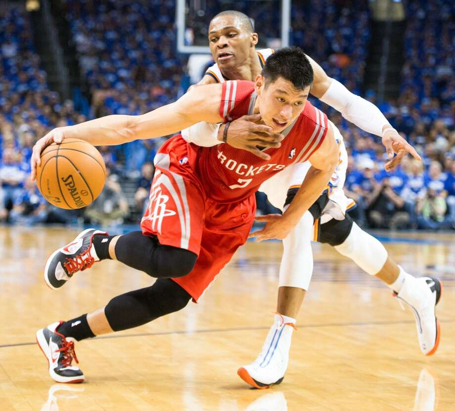 Rockets point guard Jeremy Lin is fouled by Oklahoma City point guard Russell Westbrook. Photo: Smiley N. Pool, Houston Chronicle