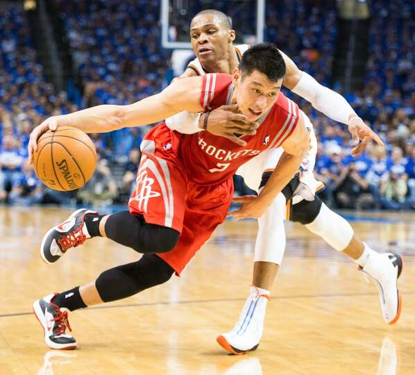 Rockets point guard Jeremy Lin is fouled by Oklahoma City point guard Russell Westbrook.