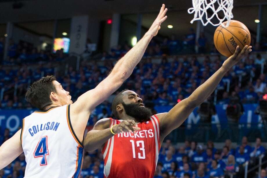 Rockets guard James Harden (13) drives to the basket past Thunder forward Nick Collison. Photo: Smiley N. Pool, Houston Chronicle