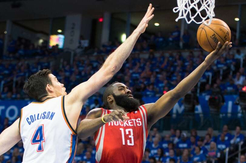 Rockets guard James Harden (13) drives to the basket past Thunder forward Nick Collison.