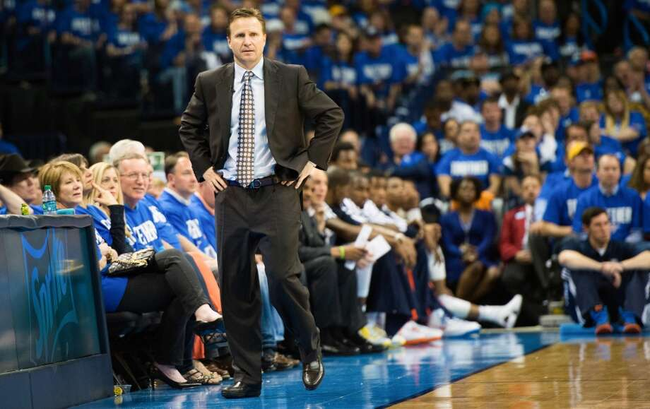 Thunder head coach Scott Brooks paces the sidelines during the second half. Photo: Smiley N. Pool, Houston Chronicle