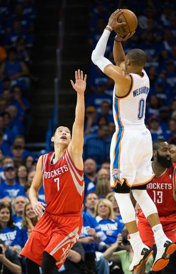 Thunder point guard Russell Westbrook shoots over Houston point guard Jeremy Lin. Photo: Smiley N. Pool, Houston Chronicle
