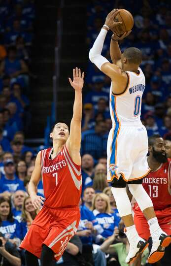 Thunder point guard Russell Westbrook shoots over Houston point guard Jeremy Lin.