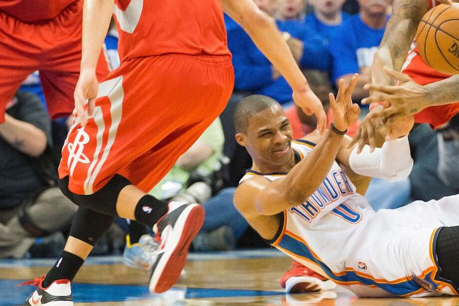 Thunder point guard Russell Westbrook fights for a loose during the first hal. Photo: Smiley N. Pool, Houston Chronicle