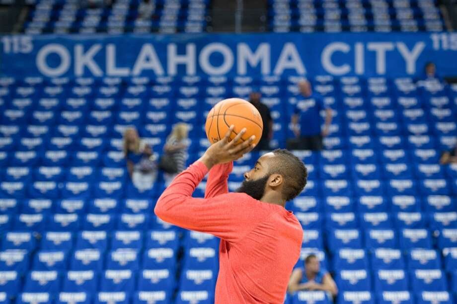 Rockets guard James Harden warms up before the game. Photo: Smiley N. Pool, Houston Chronicle