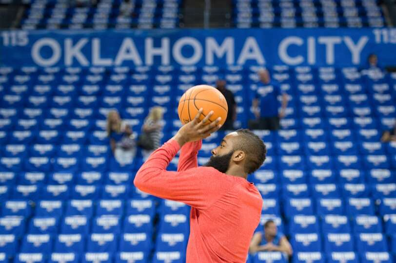 Rockets guard James Harden warms up before the game.