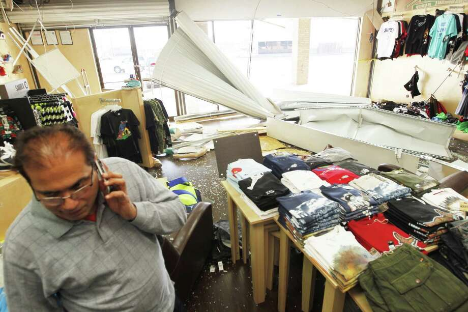 The owner of Active Athlete shoe and apparel store calls someone to help him board up his store after three men in a truck drove into his store on the 11800 block of Wilcrest Blvd. at about 4 a.m. The truck got stuck in the store and the men ran on foot. Nothing was stolen, thousands in damage to the store. (Johnny Hanson/ Houston Chronicle) Photo: Johnny Hanson