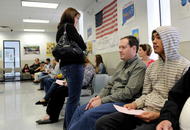 Ben Morales Right Of Norwalk Waits At The State Dept Of Motor Vehicles Office In Danbury