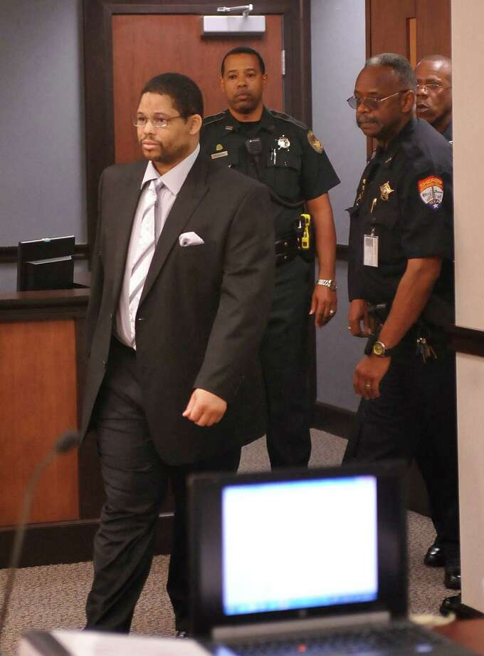The defendant, Bartholomew Granger, left, enters Judge Wortham's courtroom around 8:50 a.m. Monday morning for the start of his trial. Testimony has begun today in Galveston in the relocated capital murder trial of  Granger, who is on trial in the shooting death of Minnie Ray Sebolt, a 79-year-old Deweyville resident who was gunned down March 14, 2012, at the Jefferson County Courthouse. According to his indictment, Granger was trying to shoot a witness in an aggravated sexual assault trial in which he was the defendant and accidentally hit Sebolt. The crime is capital murder because Sebolt was killed in the commission of another crime, retaliation against a witness, according to the prosecution.    Dave Ryan/The Enterprise Photo: Dave Ryan