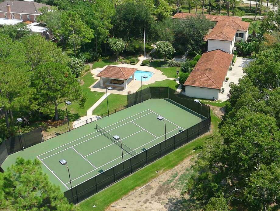This gorgeous home features five bedrooms and seven bedrooms in more than 6,500 square feet of living space. It also has plenty of unique amenities, such as a full-sized tennis court and a six-car garage. Photo: Patricia Savage