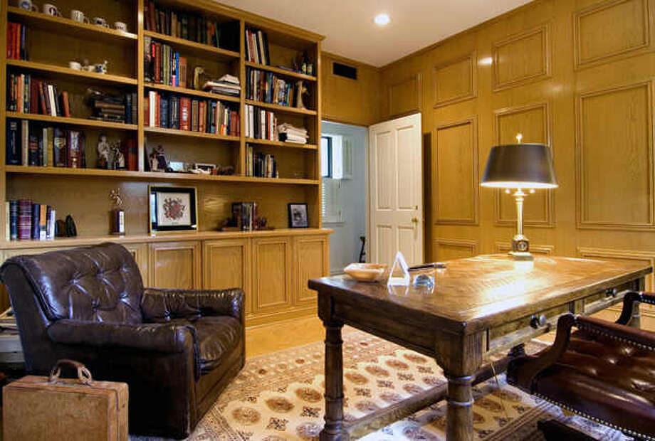 This gorgeous home features five bedrooms and seven bedrooms in more than 6,500 square feet of living space. It also has plenty of unique amenities, such as a full-sized tennis court and a six-car garage.