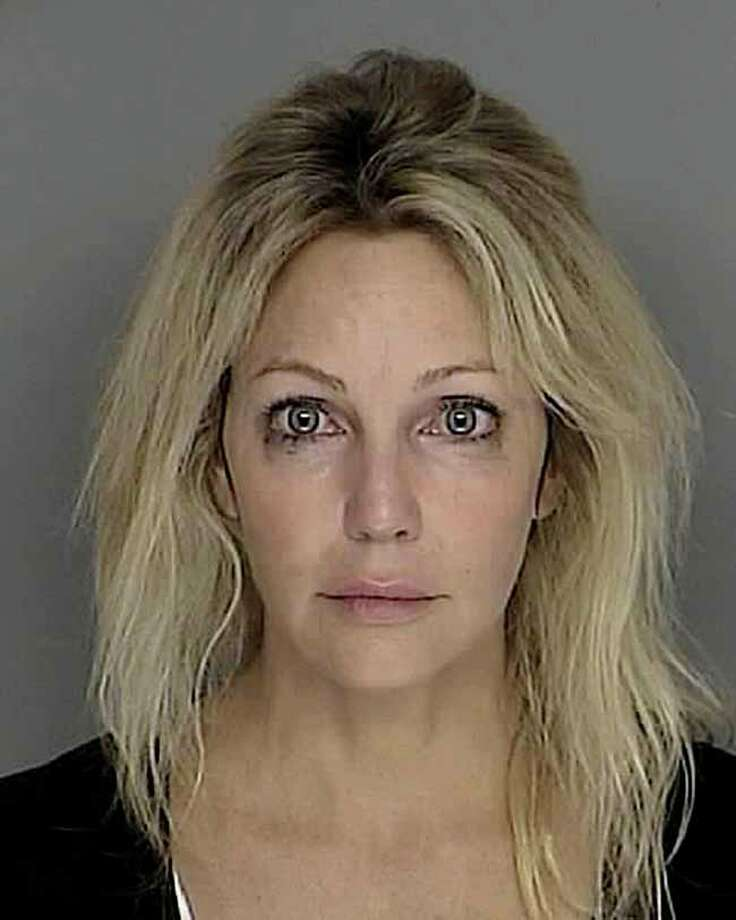 According to People magazine Heather Locklear was charged with driving under the influence of drugs in 2007 but the case was dismissed. Photo: AP / Santa Barbara Sheriffs Dept.