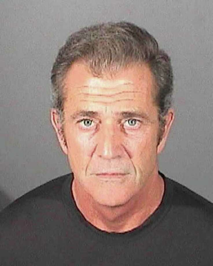 CNN reports Mel Gibson was arrested and charged in 2006. During the arrest Gibson made anti-Semitic and sexist remarks that further hurt his image. Photo: Handout, Getty / 2011 El Segundo Police Department