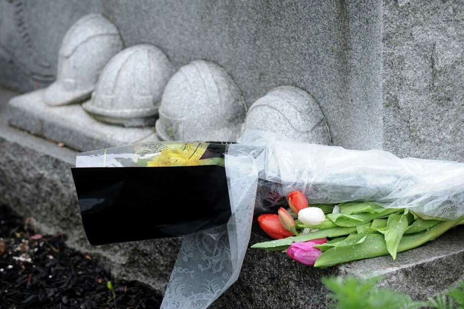 Flowers grace the monumant at city hall on the 25th Anniversary of the L'Ambiance Plaza collapse on Monday, April 23, 2012 in Bridgeport, Conn. Photo: Cathy Zuraw / Connecticut Post