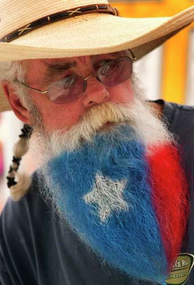 Ricky Monroe has his beard painted like a Texas Flag. Photo: J. Patric Schneider, For The Chronicle / © 2013 Houston Chronicle