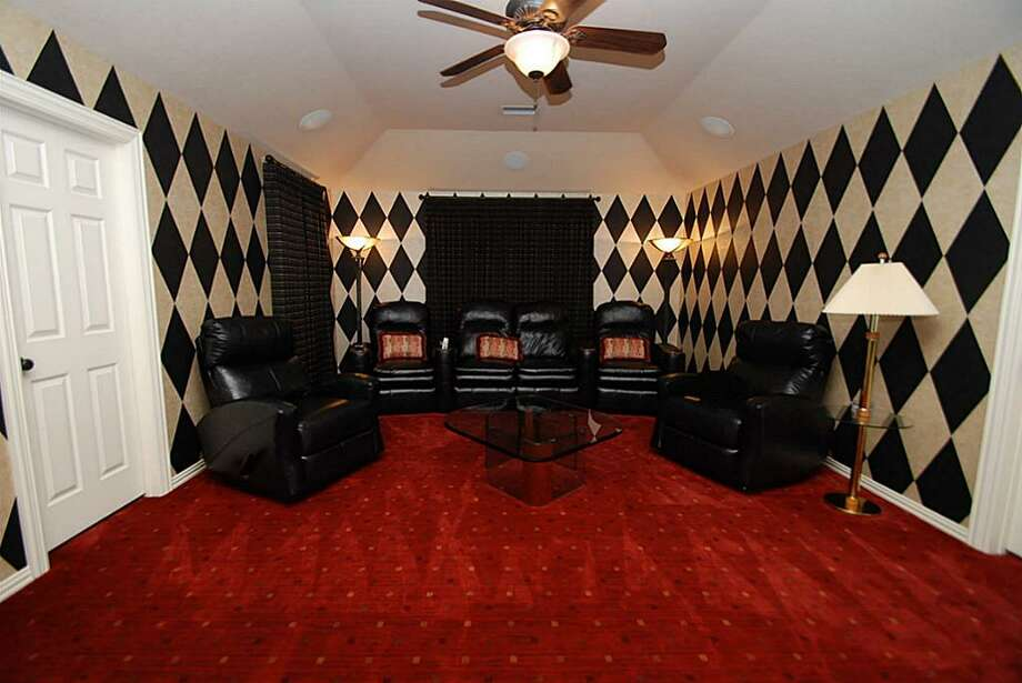 Media room - Why go to the movie theater when you can enjoy it right here in this gorgeous room. Photo: Annu Naik