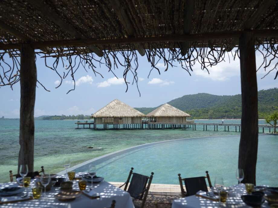 SONG SAA PRIVATE ISLAND near Sihanoukville, Cambodia Spanning two islands in the pristine Koh Rong Archipelago, the resort offers luxurious over-water and jungle- and water-view villas, all built with sustainable materials. The footbridge that connects the isles crosses over a marine reserve —  Cambodia\'s first — which was established by the resort. songsaa.com L.I.