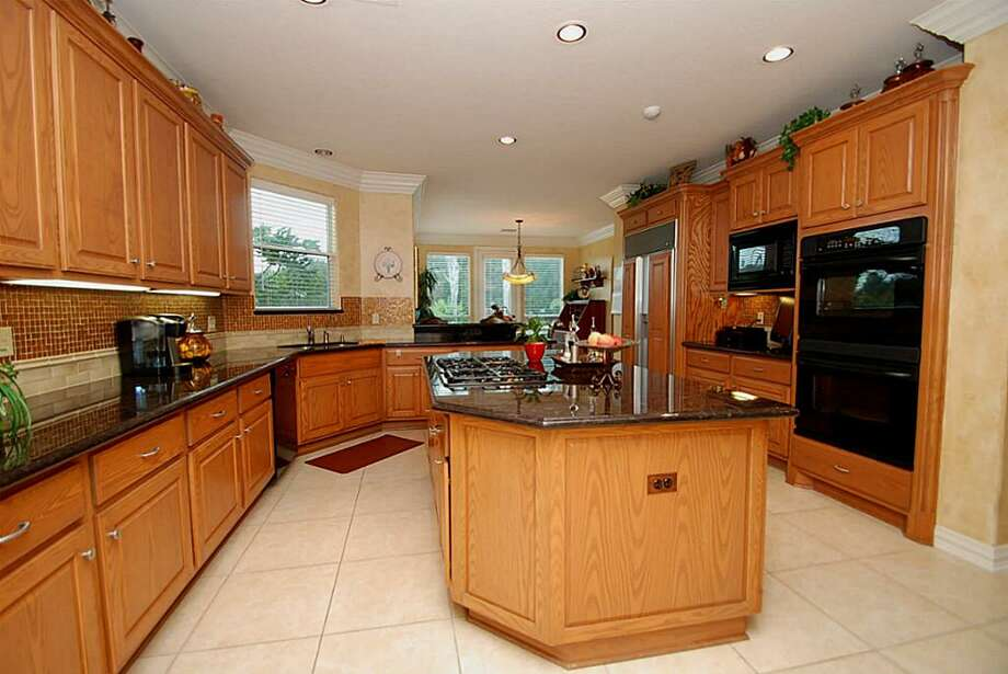 Kitchen was redone to extend the breakfast bar. It has an island counter and subzero built in refrigerator. Photo: Annu Naik