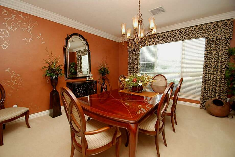 Another view of the formal dining room with custom paints. Photo: Annu Naik