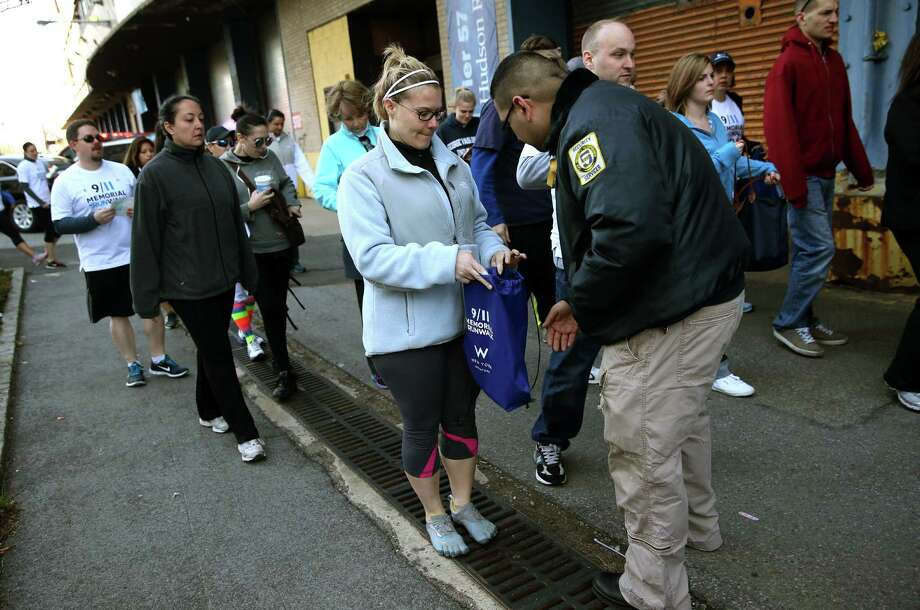 NEW YORK, NY - APRIL 21:  A security officer checks a runner's bag ahead of the 9/11 Memorial 5K Run/Walk on April 21, 2013 in New York City. Security was tight for the race, as has been the case in large scale events around the country since the Boston Marathon bombings. April 21 marks the anniversary that President Barack Obama signed into law legislation making 9/11 a day of service and volunteerism in memory of the victims of the 2001 attacks. Photo: John Moore, Getty Images / 2013 Getty Images