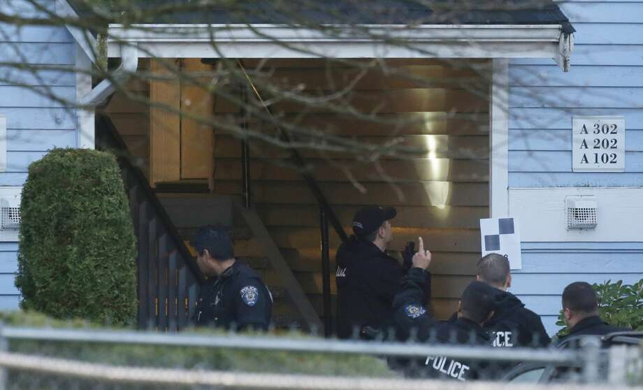 Investigators examine the  stairwell of an apartment complex, Monday in Federal  Way, where an overnight shooting left five people dead.,  including a suspect who was shot by arriving officers, police said early  Monday. (AP Photo/Ted S. Warren)