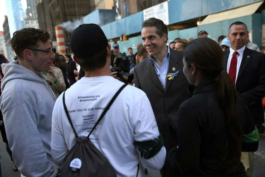 NEW YORK, NY - APRIL 21:  New York Governor Andrew Cuomo greets runners at end of the first annual 9/11 Memorial 5K Run/Walk on April 21, 2013 in New York City. Security was tight for the race, as has been the case in large scale events around the country since the Boston Marathon bombings. April 21 marks the anniversary that President Barack Obama signed into law legislation making 9/11 a day of service and volunteerism in memory of the victims of the 2001 attacks. Photo: John Moore, Getty Images / 2013 Getty Images