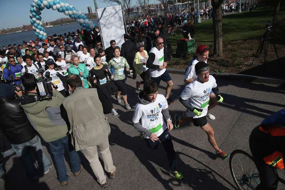 NEW YORK, NY - APRIL 21:  Runners start off on the first 9/11 Memorial 5K Run/Walk on April 21, 2013 in New York City. Security was tight for the race, as has been the case in large scale events around the country since the Boston Marathon bombings. April 21 marks the anniversary that President Barack Obama signed into law legislation making 9/11 a day of service and volunteerism in memory of the victims of the 2001 attacks. Photo: John Moore, Getty Images / 2013 Getty Images