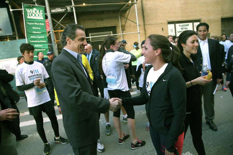 NEW YORK, NY - APRIL 21:  New York Governor Andrew Cuomo greets a runner at end of the first annual 9/11 Memorial 5K Run/Walk on April 21, 2013 in New York City. Security was tight for the race, as has been the case in large scale events around the country since the Boston Marathon bombings. April 21 marks the anniversary that President Barack Obama signed into law legislation making 9/11 a day of service and volunteerism in memory of the victims of the 2001 attacks. Photo: John Moore, Getty Images / 2013 Getty Images