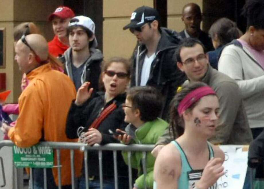 This Monday, April 15, 2013 photo provided by Bob Leonard shows third from left, Tamerlan Tsarnaev, who was dubbed Suspect No. 1 and second from left, Dzhokhar A. Tsarnaev, who was dubbed Suspect No. 2 in the Boston Marathon bombings by law enforcement.  This image was taken approximately 10-20 minutes before the blast. Photo: Bob Leonard, Associated Press