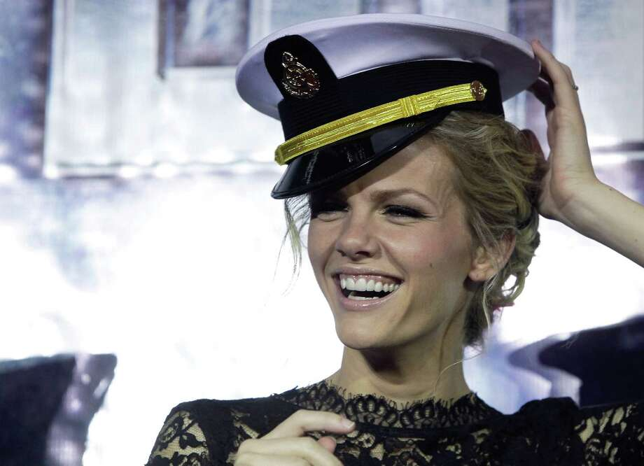 """Brooklyn Decker in someone else\'s hat during the \""""Battleship\"""" premiere in South Korea on April 5. Photo: Chung Sung-Jun, Getty Images / 2012 Getty Images"""