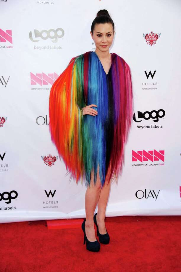 """The stripes get crazy, vertical and feathery on actress China Chow at the \""""NewNowNext Awards\"""" in Hollywood. Photo: Frazer Harrison, Getty Images / 2012 Getty Images"""