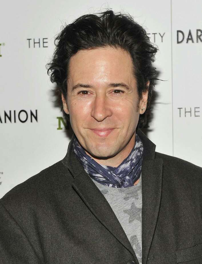 """What is that around Rob Morrow\'s neck? He\'s at the screening of \""""Darling Companion\"""" in New York City. Photo: Stephen Lovekin, Getty Images / 2012 Getty Images"""