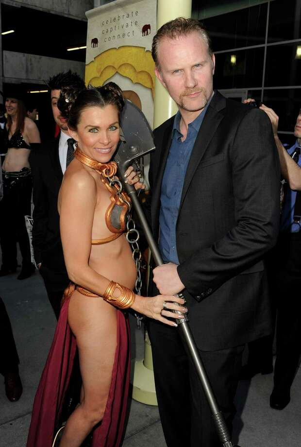 """Actress Alicia Arden and director Morgan Spurlock arrive at Spurlock\'s \""""Comic-Con Episode IV: A Fan\'s Hope\"""" at the Arclight Theater in Los Angeles. Photo: Kevin Winter, Getty Images / 2012 Getty Images"""