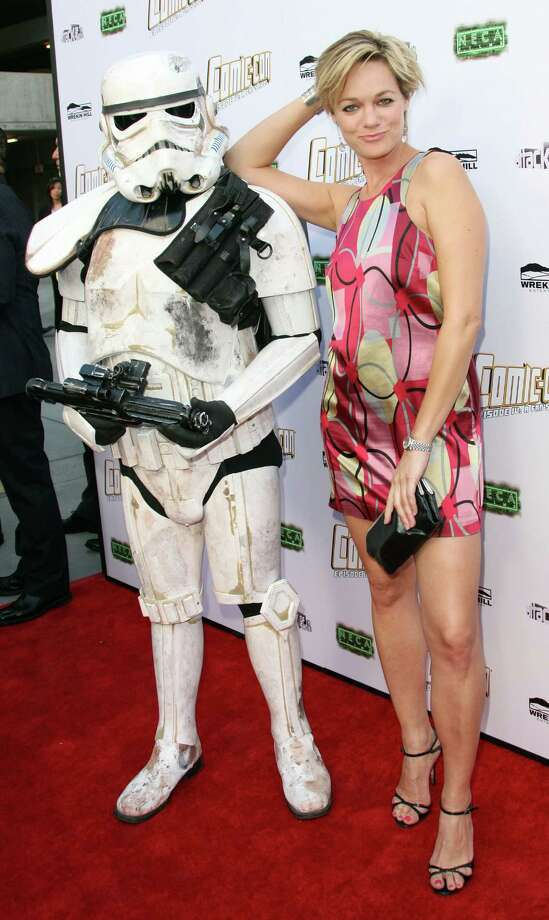 "Actress Crystal Allen and her Storm Trooper friend attend the premiere of Morgan Spurlock\'s ""Comic-Con Episode IV: A Fan\'s Hope\"" in Hollywood. Photo: Frederick M. Brown, Getty Images / 2012 Getty Images"
