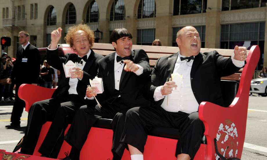 """Is it Curly, Moe and Larry? Or is it Curly, Moe and Shemp? It doesn\'t matter. It\'s really actor Sean Hayes, left, Chris Diamontopoulos and Will Sasso at the premiere of \""""The Three Stooges\"""" in Los Angeles. Photo: Kevin Winter, Getty Images / 2012 Getty Images"""