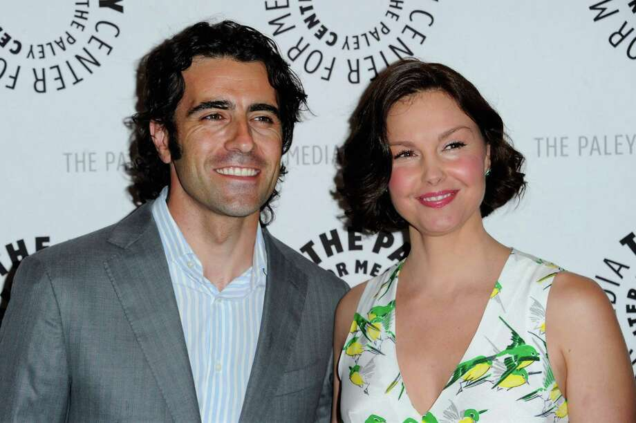 """Ashley Judd penned an eloquent column in The Huffington Post against critics who made fun of her puffy face. She\'s seen here with her husband, race-car driver Dario Franchitti, at the The Paley Center for Media screening of the TV show \""""Missing\"""" in Beverly Hills. Photo: Alberto E. Rodriguez, Getty Images / 2012 Getty Images"""