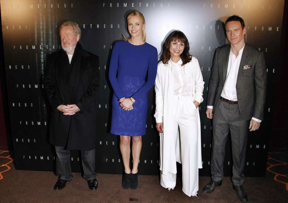 """Everyone seems in their own world. It\'s film director Sir Ridley Scott, left, Charlize Theron, Noomi Rapace and Michael Fassbender at the premiere of the movie \""""Prometheus\"""" in Paris. Photo: THOMAS SAMSON, AFP/Getty Images / TS"""