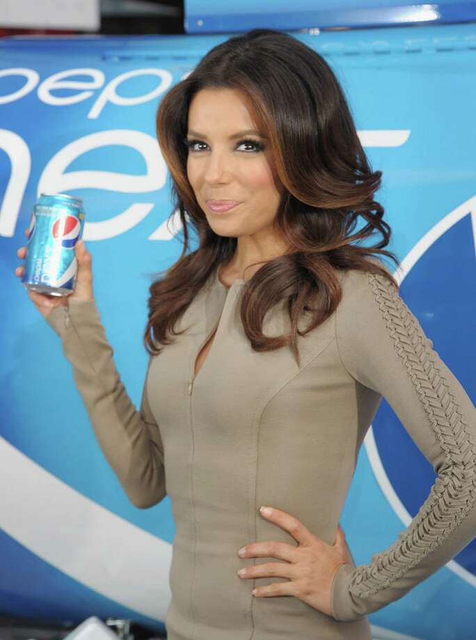 "Eva Longoria promotes Pepsi\'s ""Next Drink It To Believe It\"" event in Times Square in New York City. Photo: Michael Loccisano, Getty Images / 2012 Getty Images"