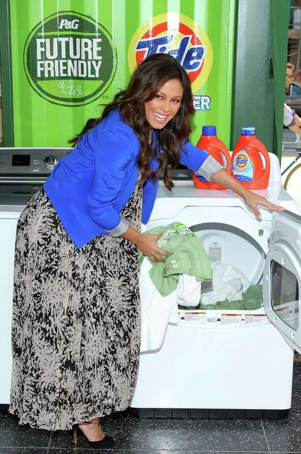 "Actress Vanessa Lachey pretends to do laundry at the ""Take A Load Off\"" campaign in Hollywood. Photo: Mark Davis, Getty Images / 2012 Getty Images"