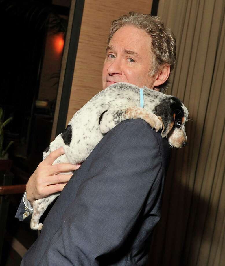 "Kevin Kline poses with a puppy from The North Shore Animal League at a screening party for ""Darling Companion.\"" Photo: Stephen Lovekin, Getty Images / 2012 Getty Images"