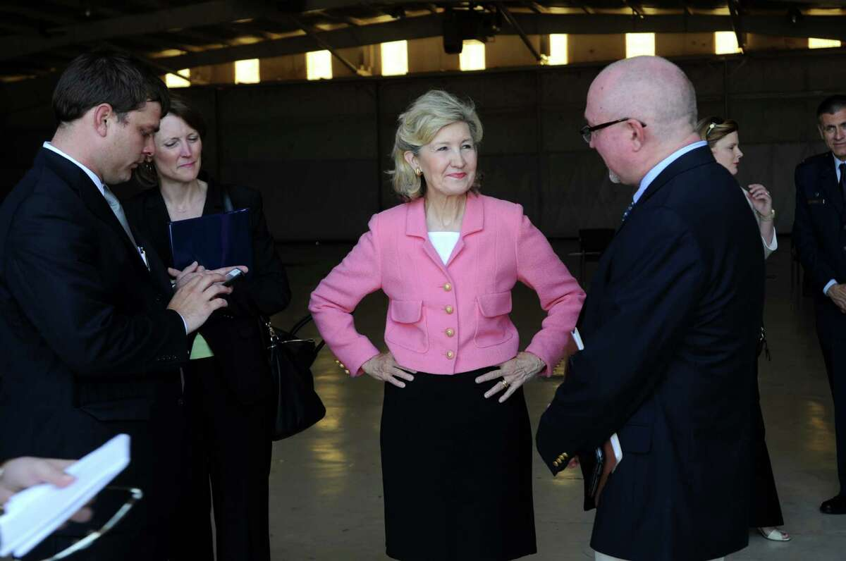 Sen. Kay Bailey Hutchison, center, talks to Lynn Lunsford, right, public affairs manager with the Federal Aviation Administration after a tower dedication ceremony at Abilene Regional Airport Wednesday, May 2, 2012, in Abilene, Texas.