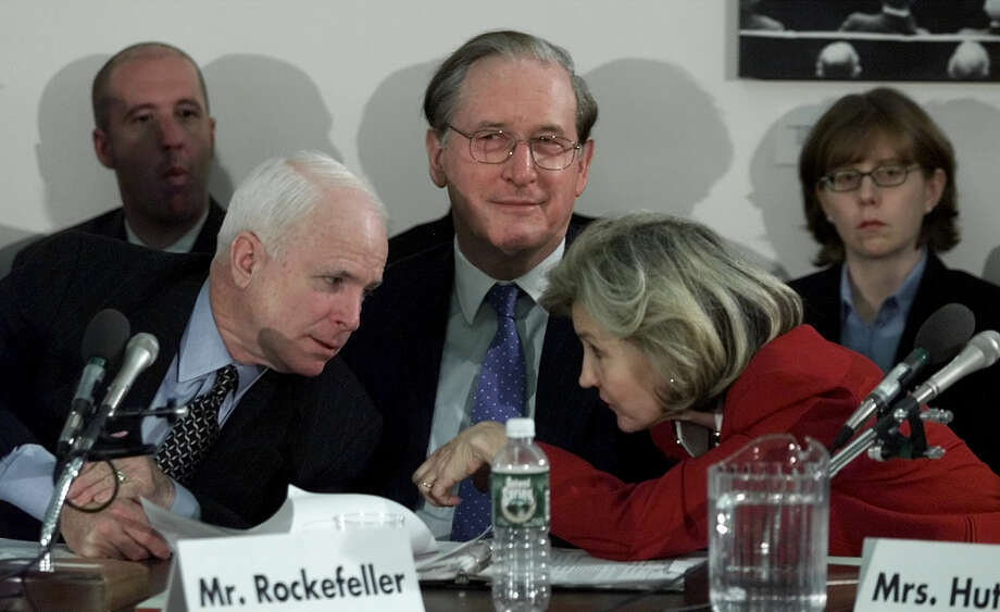 Sen. John McCain, R-Ariz., leans over to talk with Sen. Kay Bailey Hutchison during a hearing between House and Senate members about an aviation security bill Tuesday, Nov. 13, 2001, at the Capitol in Washington. Photo: Joe Marquette, The Associated Press / AP